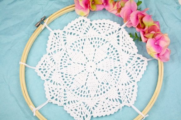 Tie the crocheted doily using white ribbon | CatchMyParty.com