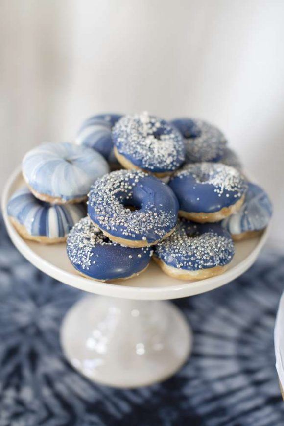 Gorgeous donuts with blue icing at this pretty boho baby shower