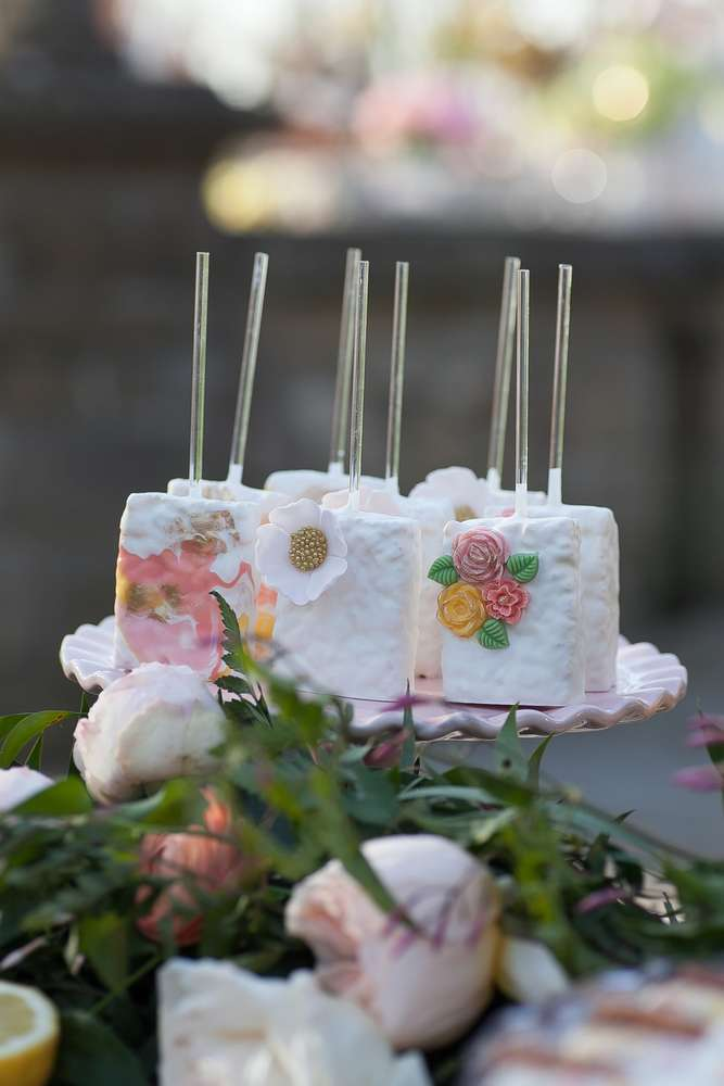 Pretty white Krispie treats decorated with delicate flowers at this wonderful Mother's Day brunch