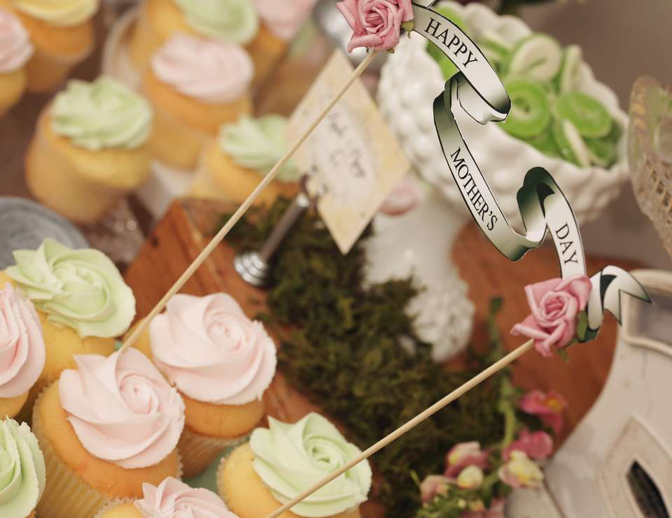Mother's Day Garden sweets table - lollies & cupcakes in a vintage garden setting