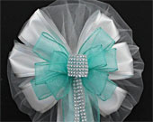 Aqua-bling-glitter-white-sparkle-wedding-pew-bows-170